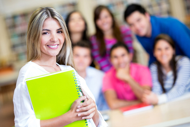 Beautiful female student smiling at the university